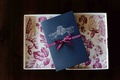 Dark blue wedding invites with fuchsia backing