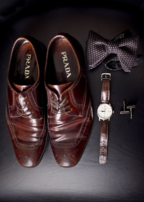 men's prada dress shoes in brown, brown leather watch, patterned bow tie and cuff links