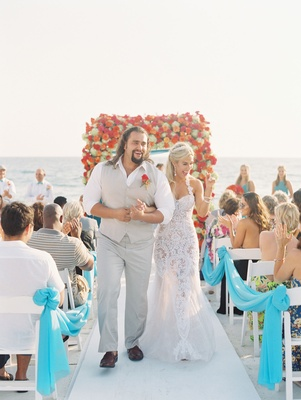 "CJ ""Lana"" Perry and Miroslav ""Rusev"" Barnyashev walking up white aisle wedding ceremony beach Malibu"