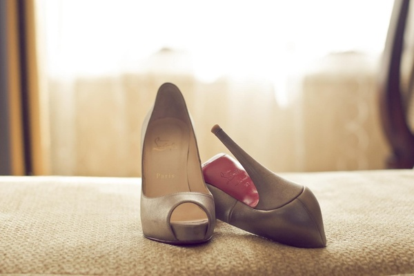 Nude Christian Louboutin shoes with red sole