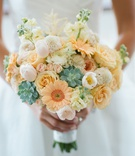 Wedding bouquet daisy rose succulent tulip ranunculus peach orange green white yellow pink