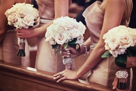 Bridesmaids at ceremony holding nosegays