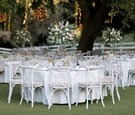 saddlerock ranch wedding, outdoor reception, white linens, white-washed vineyard chairs