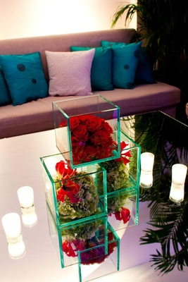 Wedding lounge section with mirror table and cube vases