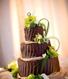 Chocolate wedding cake with green and white flowers
