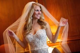 Bride in Pnina Tornai wedding dress and Toni Federici veil