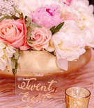 wedding reception pink white flowers peony rose gold vase bowl lucite table number gold calligraphy