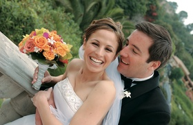 Bride and groom hold tropical bouquet