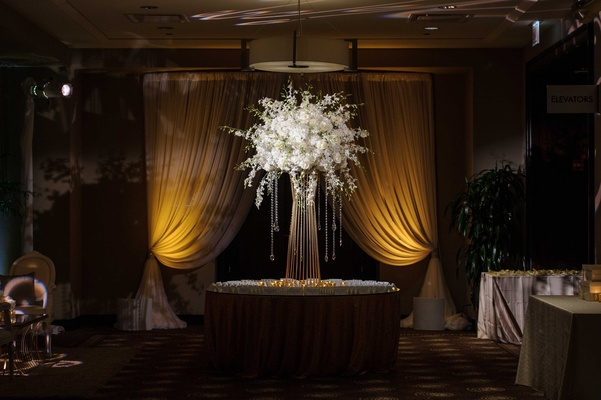 large floral display with crystals for escort card table at NYE wedding reception