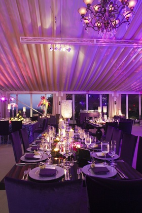 Long rectangular table at purple wedding with crystal candlestick