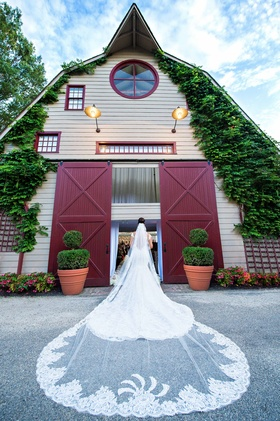 Megan Wollover at New Jersey wedding venue with lace trim Ines Di Santo cathedral wedding veil