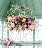 floral chandelier shaped like a sphere with cascading crystal accents