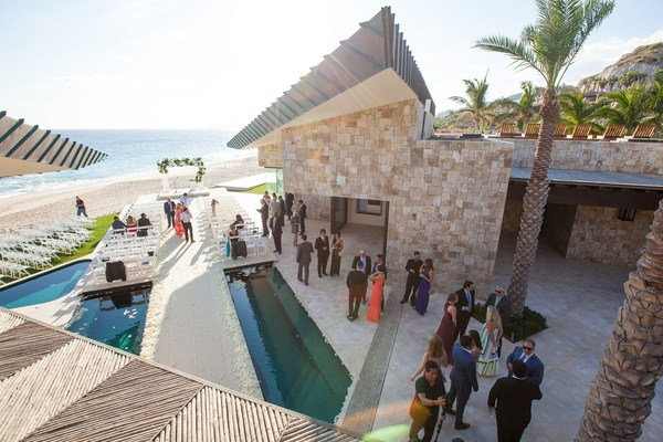 destination wedding ocean views, ceremony and aisle built over pool