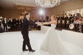 bride in mira zwillinger wedding dress with mark ingraham overskirt, groom in tux, fun first dance