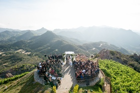Malibu Rocky Oaks Vineyard Estate wedding ceremony on helipad overlooking Santa Monica mountains
