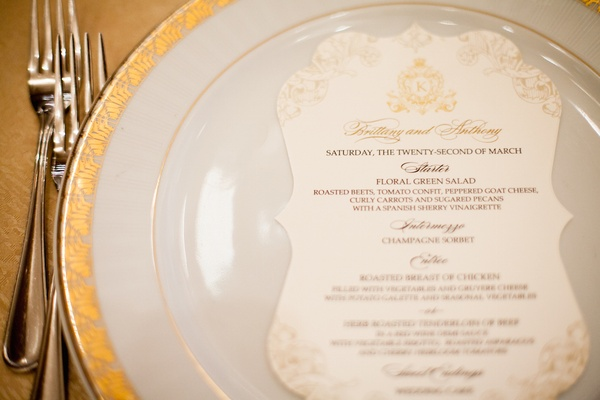 White and gold dinner menu on plate