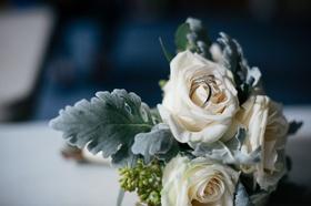 Wedding rings diamond eternity band men's ring women's ring bride and groom on white rose flower
