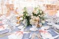 wedding reception round table blue linen low short centerpiece candles pink peach accent color