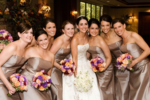 Bride with bridesmaids in light brown shimmery dresses