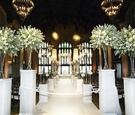 Green and ivory flowers on pedestals