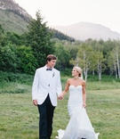 Bride in strapless inbal dror wedding dress with groom in white tuxedo jacket bow tie sundance utah