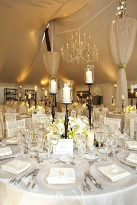 Tent wedding reception with white flowers and decor