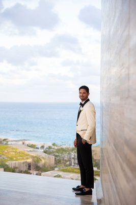 wedding portrait groom at cabo resort white tuxedo jacket loafers no socks black pants