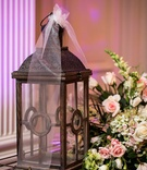 Wedding reception table with wood lantern white roses, lisianthus, pink roses, green hydrangeas