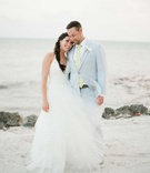 Destination wedding beach bride halter dress with tulle skirt Vera Wang and groom in light suit