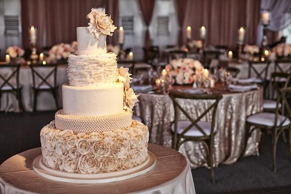 Wedding cake with rose, ruffle, and peony decorations