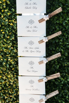 Wedding place cards in calligraphy with flower clothing pins