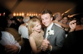 groom dances with mother at reception
