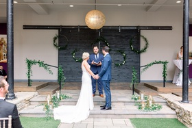 wedding at hotel covington with hoops of greenery, friend officiating wedding
