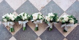 Bridesmaid bouquets with white ranunculus and rose flowers