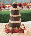 Five layer chocolate cake with ivory flower decorations