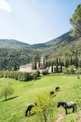 wedding venue ideas destination location umbria green grass mountains trees old historic abbey hotel