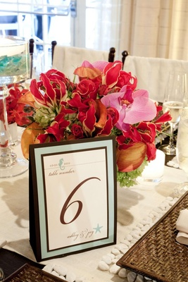 Free standing table card with blue border and sealife motif