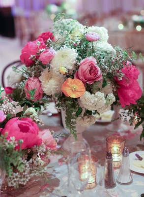 Hot pink and white spring flower centerpiece at wedding