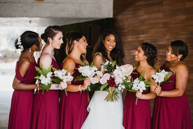 bride in eve of milady wedding dress, bridesmaids in jj's house burgundy dresses