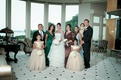 Flower girls and bride in tiered ball gowns with family