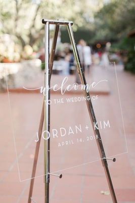 outdoor wedding welcome sign white lettering acrylic lucite silver easel