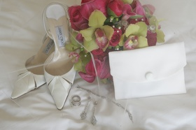 Jimmy Choo wedding shoes and white fold bridal bag