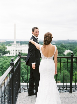 Bride in wedding dress with beaded back low scoop back lace groom in tuxedo first look washington dc