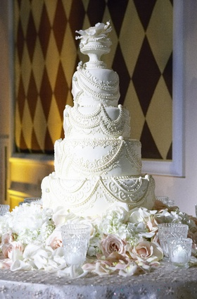 Four layer white cake with intricate details