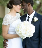 couple nose to nose wedding attire southern california nuptials lace navy white flowers