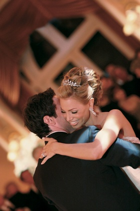 Bride in a tiara and groom having their first dance