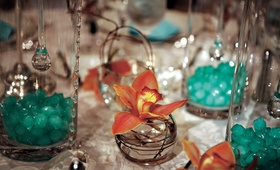 Tiffany blue crystals inside glass vase wedding centerpiece