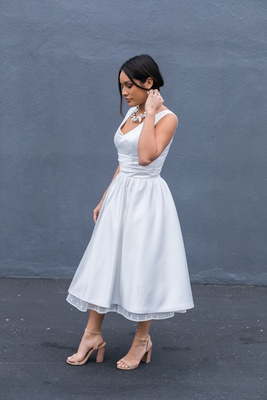 A new twist on a classic. this v-neck tea length wedding dress wtih peek a boo polka dot hem is a pe