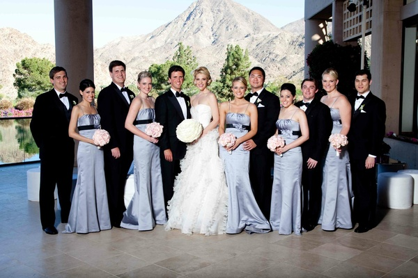 Blue bridesmaids and groomsmen in tuxedos