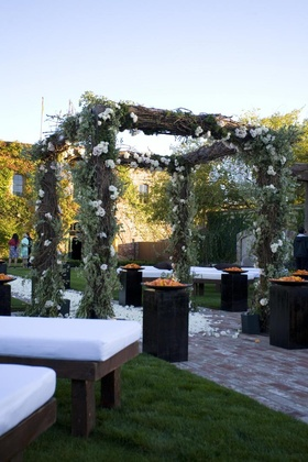 Wooden bench ceremony seats and rustic chuppah